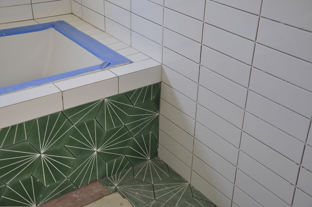 'Dandelion' Moroccan cement tile installed in the guest bath.
